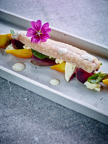 Smoked eel with red and yellow beet and goat's cheese