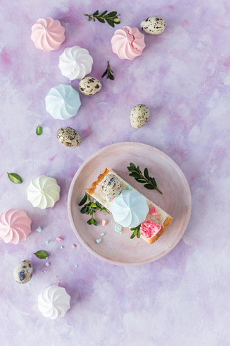 Slice of a Polish Easter cake with colorful meringues