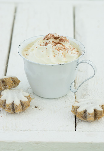 Hot chocolate with cream and cinnamon biscuits
