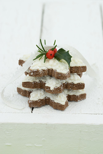 Snowflake biscuits with holly berries