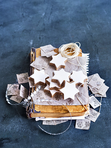 Cinnamon stars on an old book