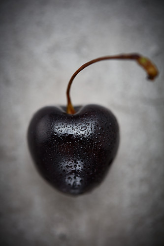 A cherry with drops of water