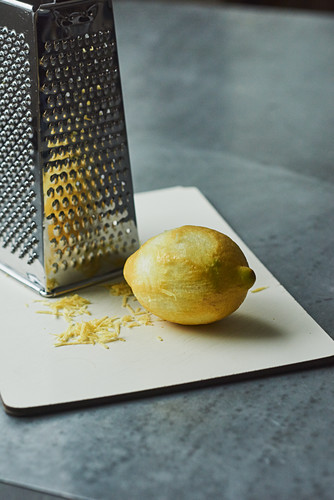 Lemon zest being grated with a vegetables grater