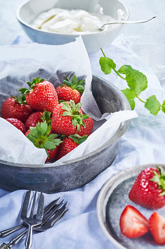 Strawberries with whipped cream and mint
