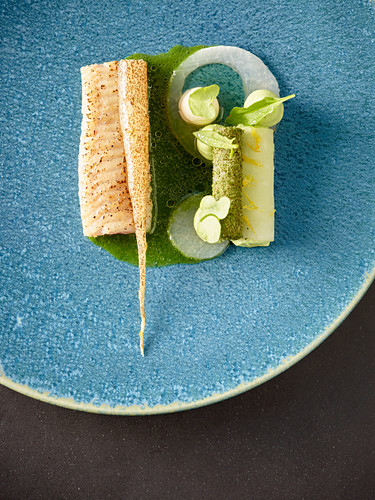 Fried wrasse with sorrel and radish