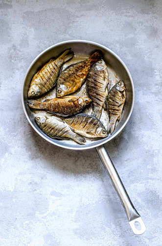 Fried fish in a pan
