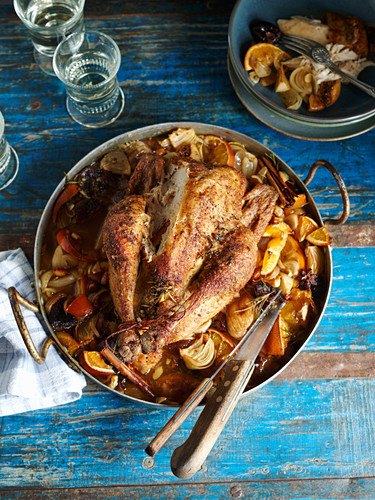 Spanish chicken on a bed of oranges, onions and dried fruit