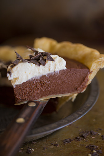 A piece of chocolate pie with cream