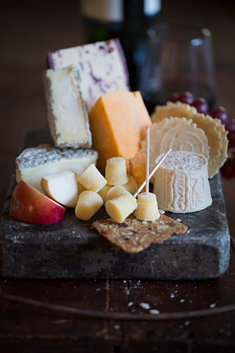 Cheese board still life with crackers and fruits