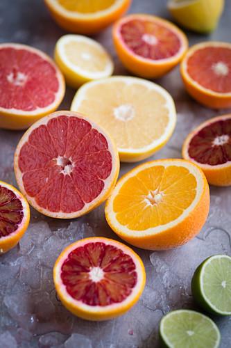 Assorted citrus fruits cut in half