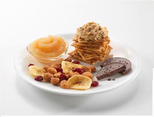 Snacks: crackers with tuna cream, applesauce, trail mix and chocolate