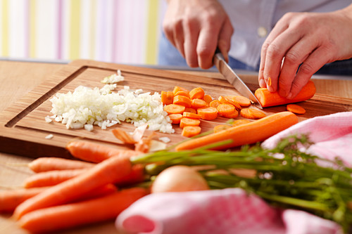 Onions and carrots being chopped