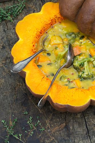 Pumpkin broccoli soup in a pumpkin bowl