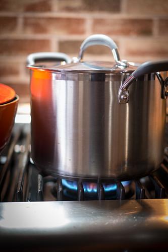 A large pot on a gas hob