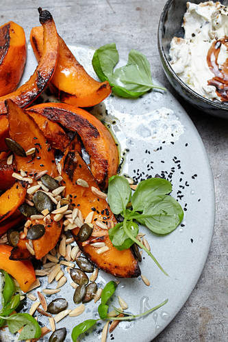 Pumpkin wedges with aubergine and pomegranate syrup yoghurt
