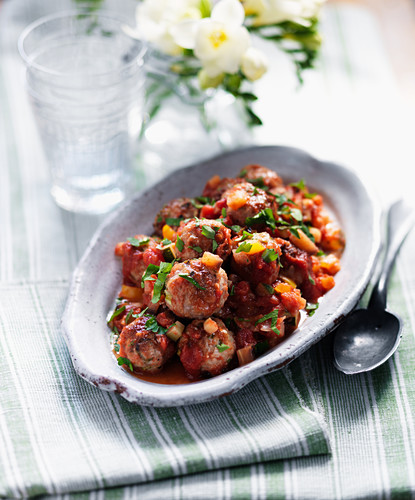 Pork balls with carrots, salsa and herbs
