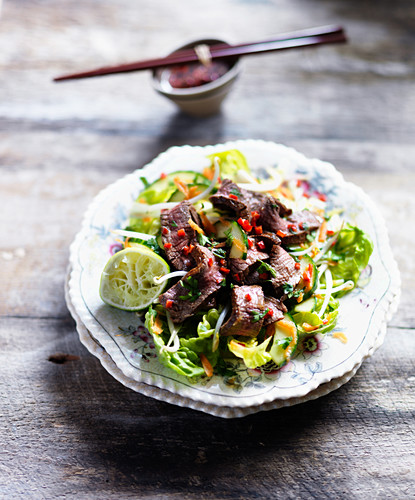 Spicy beef salad with lime, chilli, cucumber and lettuce