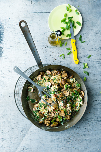 Scrambled eggs with wild herbs and mushrooms