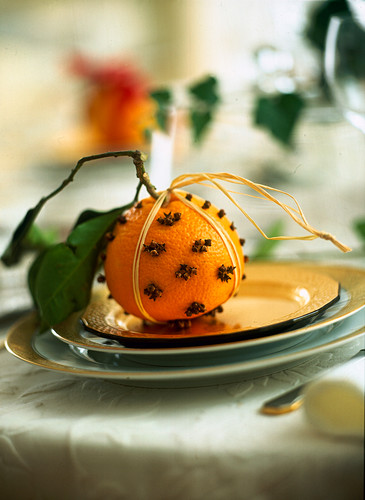 An orange stuck with cloves as decoration