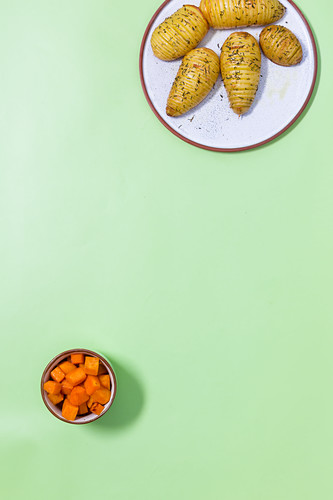 Sweet potato chips and Hasselback potatoes thyme