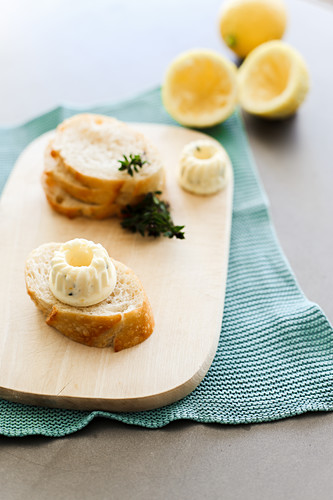 Slices of baguette with lemon butter