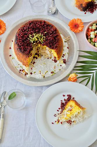 Tah Chin-e Morgh (a saffron rice cake, Persia) with marinated chicken