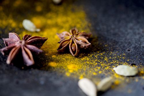 Turmeric powder, cardamom pills and star anise (turmeric latte ingredients)