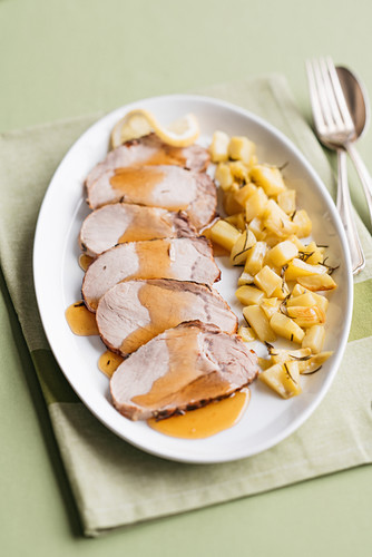 Oven roasted pork with caramelized lemon sauce and potatoes
