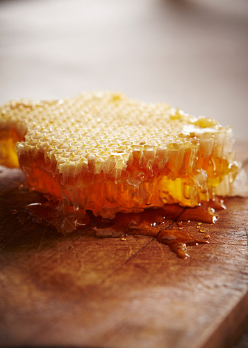 Close up of honey comb with honey dripping out