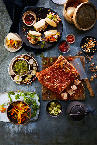 Overhead table shot with meat, sandwiches, salads and tea