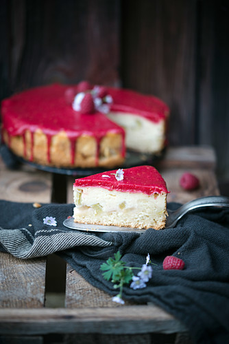Vegan cake with pudding and rhubarb filling and raspberry sauce