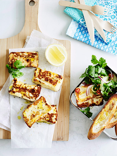 Fried haloumi with lemon, coriander and pine nuts for lunch