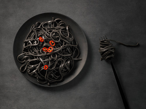 Black pasta with red pepper