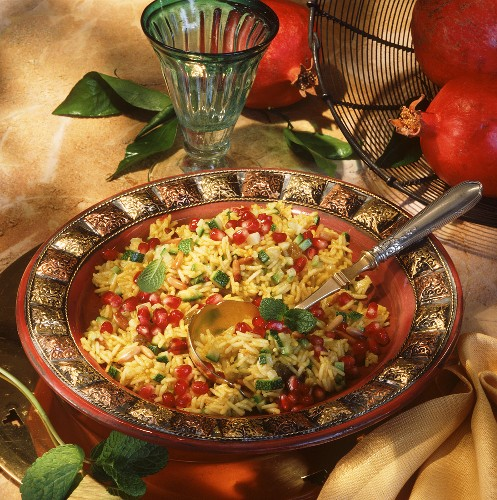 Saffron rice with pine nuts, courgettes & pomegranate seeds