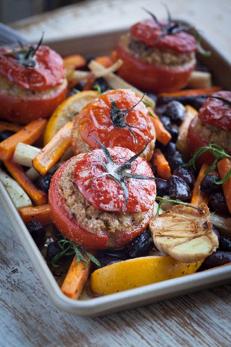 Tomatoes filled with amaranth and halloumi with root vegetables