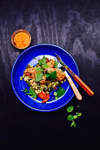 Couscous salad with peppers, carrots, zucchini, mint, teriyaki chicken and sesame, with Ajvar