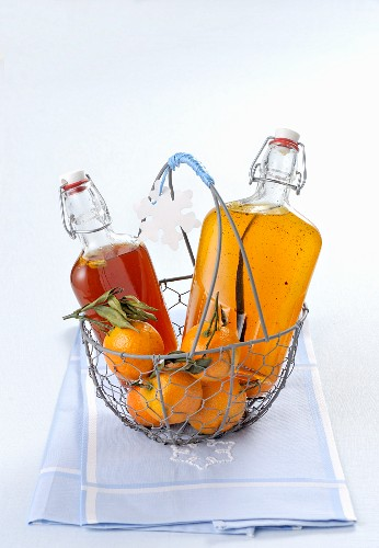 Orange and mandarin syrup in flip-top bottles