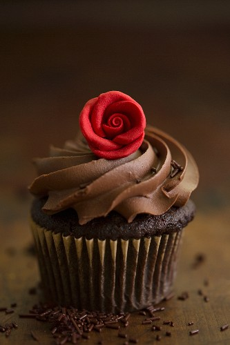 A chocolate cupcake with a rose decoration for Valentine's Day