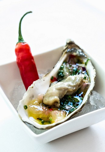 A ready-to-eat oyster on ice