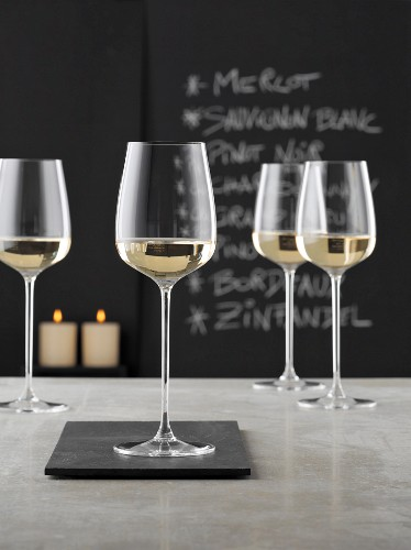 Glasses of white wine on a grey counter in a wine bar