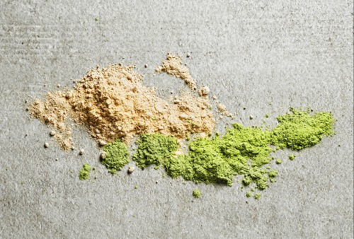 A pile of maca powder and barley sprouts powder (seen from above)