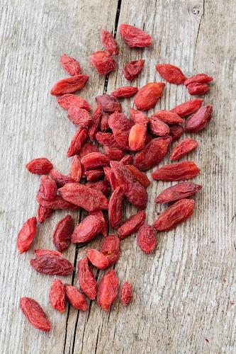 Dried goji berries on wooden background