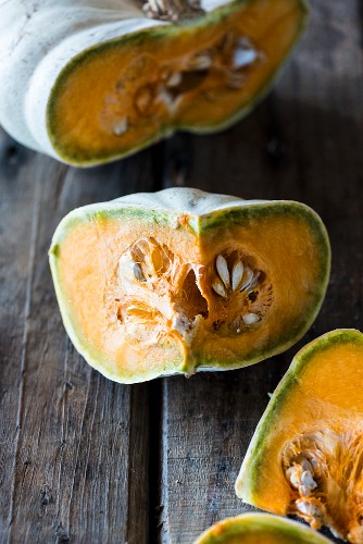 Sliced pumpkin on a wooden surface