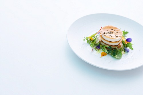 Goat's cheese lasagne with strudel pastry and a herb salad
