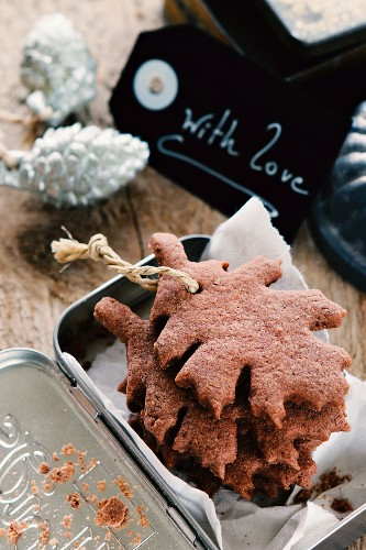 Gluten-free leaf shaped chocolate biscuits to be hung up as decorations