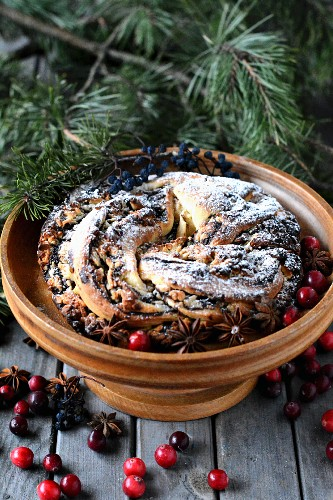 Christmas wreath cake with chocolate, cranberries and start phase