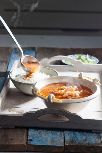 Steaming bean soup with chicken on a tray