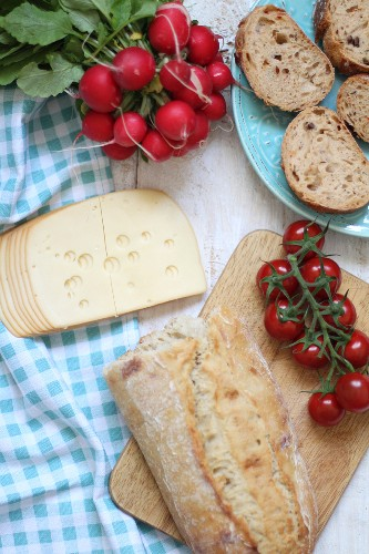 Supper with bread, cheese, radishes and tomatoes