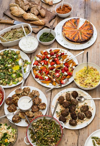 Various dishes and bred on a rustic buffet