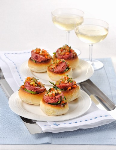 Pane condito con cotechino (rolls topped with raw sausage meat, Italy)